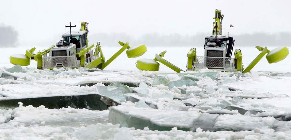 The province's new Amphibex AE 400 starts breaking ice north of Selkirk, Manitoba on the Red River.  February 21, 2012  (BORIS MINKEVICH / WINNIPEG FREE PRESS)