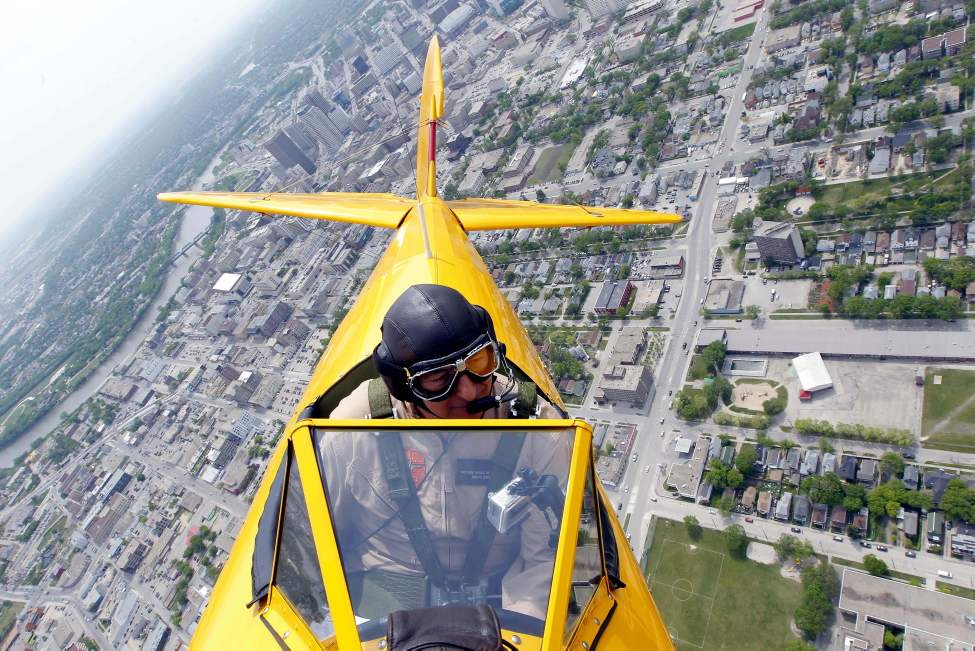 Vintage Wings pilot Bruce Evans flies the Boeing Stearman over Winnipeg Friday afternoon. May 18, 2012  (BORIS MINKEVICH / WINNIPEG FREE PRESS)