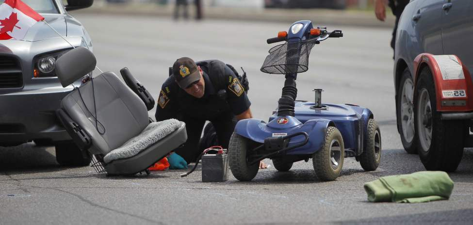 A pedestrian was taken to hospital late this morning following a collision with a vehicle at Portage Avenue and Rouge Road. A police release just before 1 p.m. called the collision 'a serious motor vehicle collision involving a pedestrian.'  July 24, 2012  (BORIS MINKEVICH / WINNIPEG FREE PRESS)