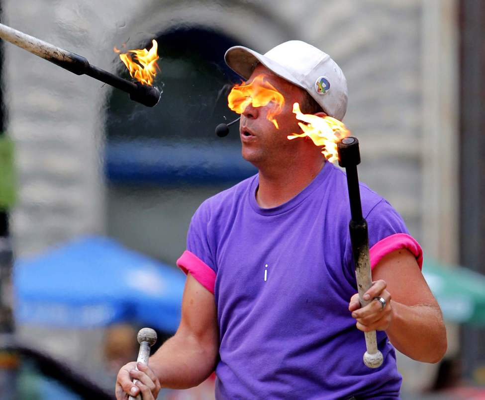 Fringe at Old Market Square - Chris Without the Hat juggles fire for the crowds. July 18, 2012  (BORIS MINKEVICH / WINNIPEG FREE PRESS)