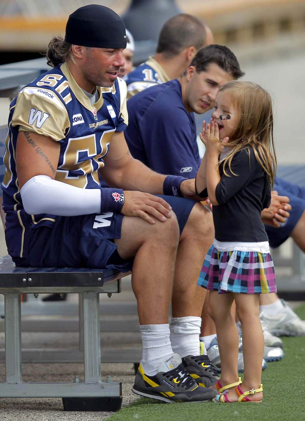 Winnipeg Blue Bomber Chris Cvetkovic has a moment with his daughter Payton,5, during a break in practice. July 25, 2012  (BORIS MINKEVICH / WINNIPEG FREE PRESS)