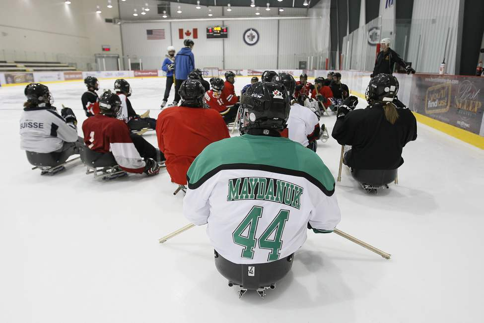 Losing his legs wasn't going to keep Cole off the ice. Attending a sledge hockey open house was another big part of the recovery process. He later says being in the locker room that day was the first time he felt like himself again.
