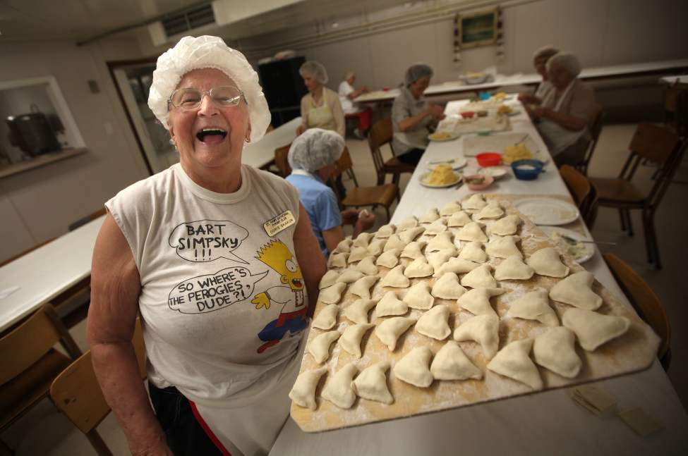 Perogy Club at St. Ivan Suchavsky Ukrainian Orthodox cathedral - Doris Skakun, 90, who has been making perogies there every week since 1967, holds a wooden tray of perogies to be cooked before packaging.  June8, 2012  (Phil Hossack Winnipeg Free Press)