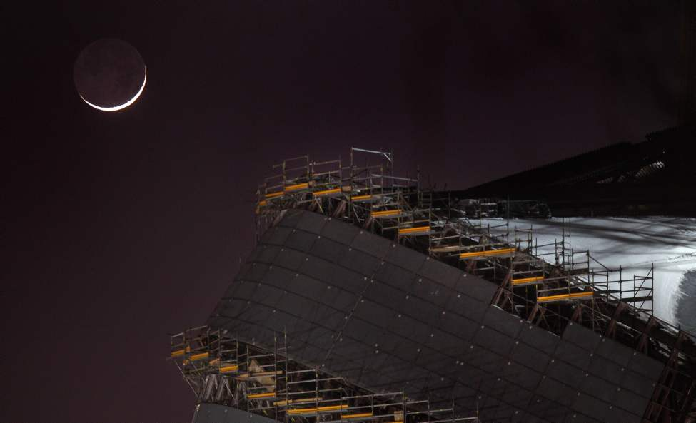 The first New Moon of 2012 hangs over the Canadian Museum for Human Rights construction Tuesday night, marking the first day of the Chinese Year of the Dragon.  January 25, 2012  (Phil Hossack / Winnipeg Free Press)