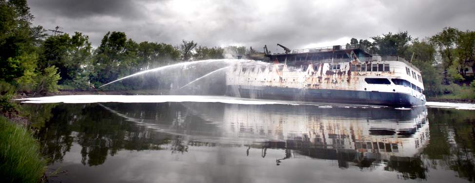 Reduced to a smoking hulk, the MS Lord Selkirk lays listing in the Selkirk Slough, ironically the very body of water it was built beside and launched into. June 19, 2012  (Phil Hossack / Winnipeg Free Press)