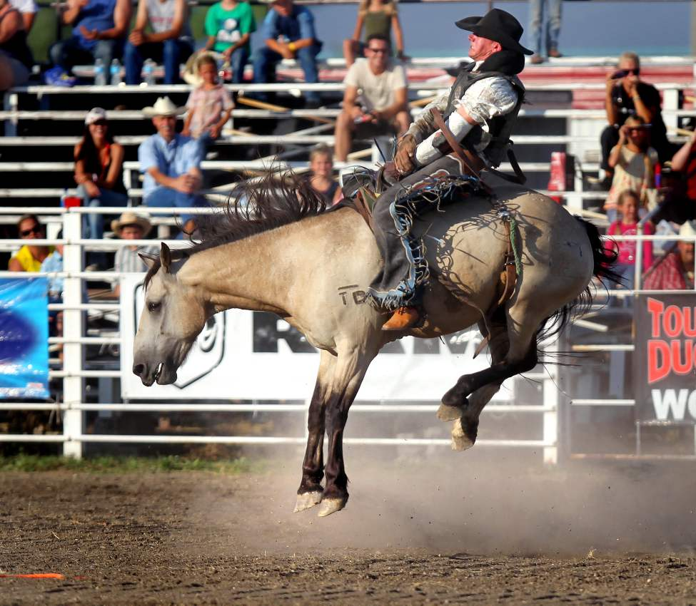 Logan Hudson, defending Canadian Saddle Bronc Rider takes a ride on a rocket launcher named