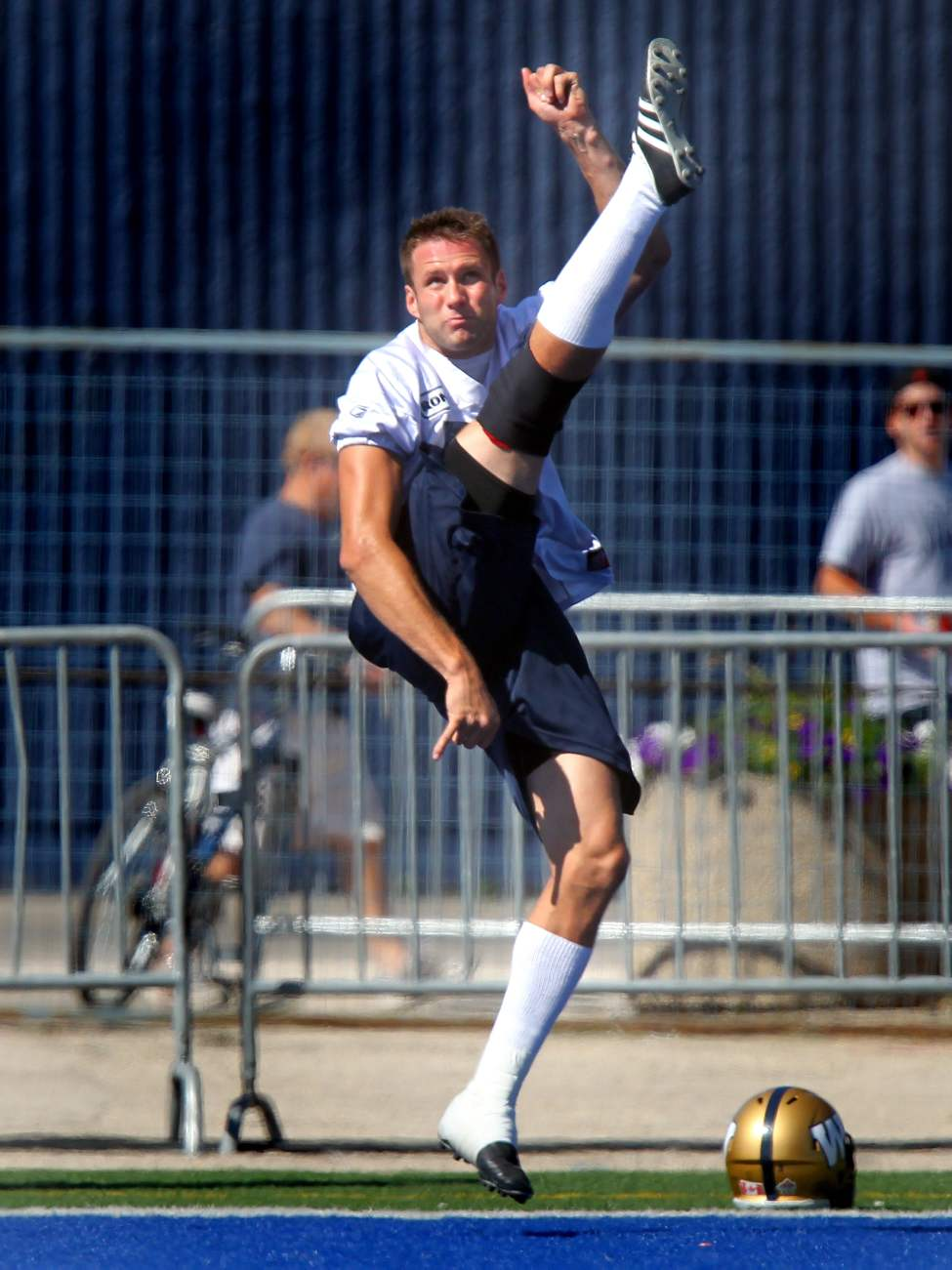 An airborne Mike Renaud shows off his punting form at the Bombers' mid-day workout Friday.  August 31, 2012  (Phil Hossack / Winnipeg Free Press)