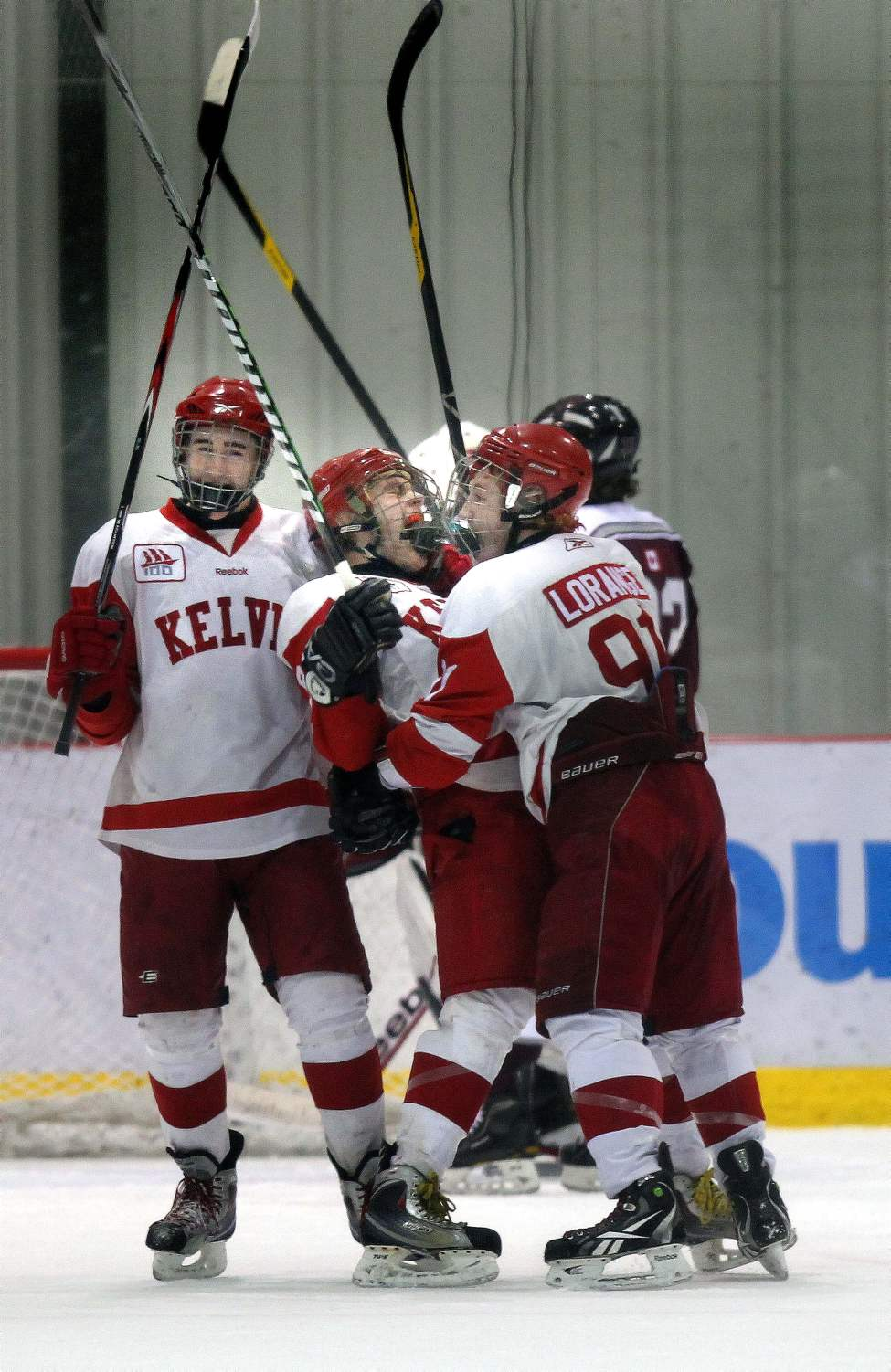 Kelvin Clipper #89 Scott Douglas (center) celebrates with #11 Dylan Allary  (left) and  #91 Mike Lorange after he scored the team's opening point to tie St Paul's at 1-1 in the first period of playoff finals Monday. March 6, 2012  (Phil Hossack / Winnipeg Free Press)