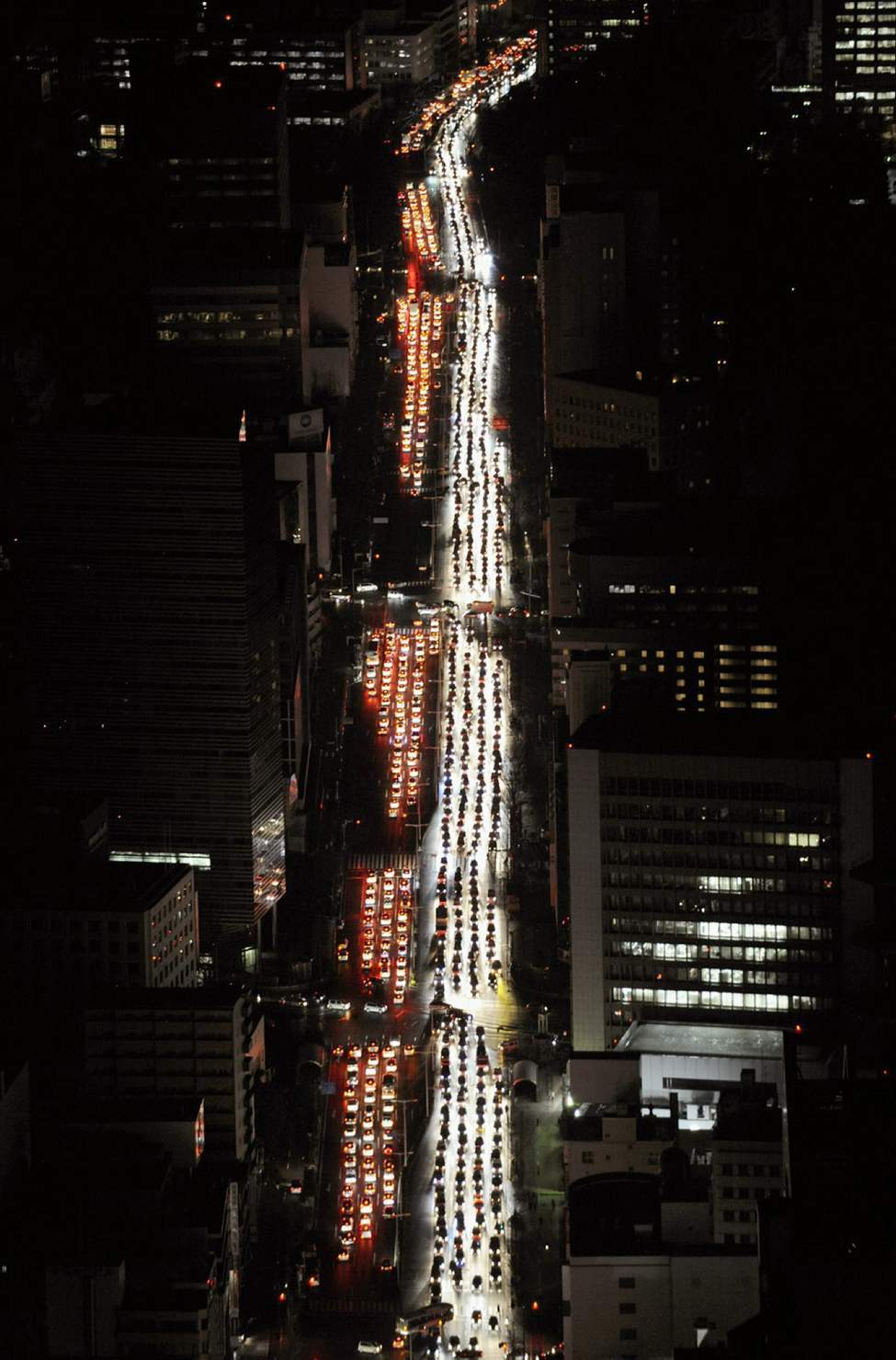 Traffic is jammed on a road in Sendai city, Miyagi prefecture (state), Japan, after a powerful earthquake, the largest in Japan's recorded history slammed the eastern coasts Friday, March 11, 2011.  (AP Photo/Kyodo News)