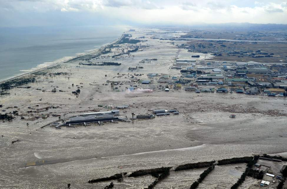 Earthquake-triggered tsunami sweeps the shore as Sendai Airport is surrounded by waters in Miyagi prefecture (state), Japan, Friday, March 11, 2011. The ferocious tsunami spawned by one of the largest earthquakes ever recorded slammed Japan's eastern coasts. (AP Photo/Kyodo News)