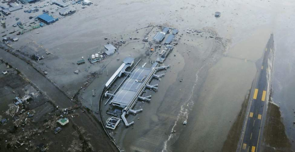 The tarmac and surrounding area of Sendai Airport is covered with water after a tsunami at in Sendai, Miyagi Prefecture Japan on Friday, March 11, 2011. A ferocious tsunami spawned by one of the largest earthquakes ever recorded slammed Japan's eastern coast Friday, killing hundreds of people as it swept away boats, cars and homes while widespread fires burned out of control. (AP Photo/Kyodo News)  (CP)