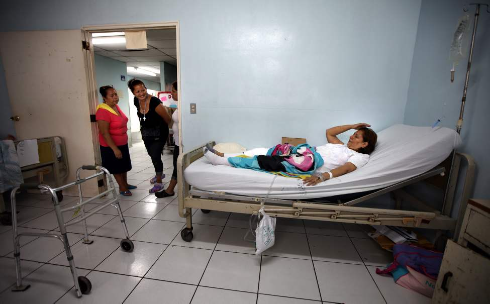 MANAGUA - Sylvia Vega is greeted by smiling visitors as she arrives on the ward after surgery in Managua.