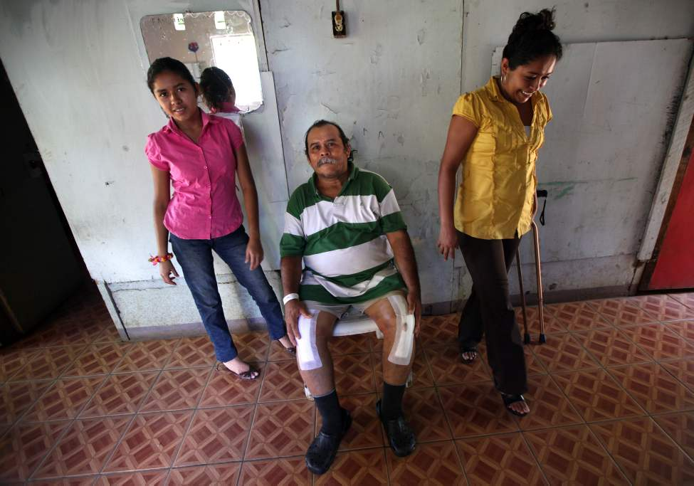 MANAGUA - Happy to be home at last, a beaming Juan Canda rests by his daughters Cindy, left, and Alycia.