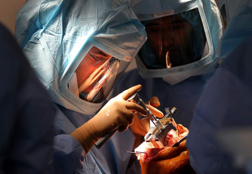 WINNIPEG - Turgeon performs knee replacement surgery at Concordia Hospital.