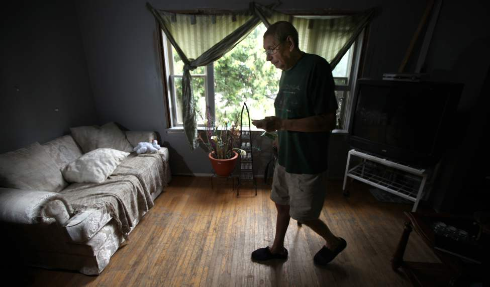 WINNIPEG - DesJardins makes his way across his living room three weeks after surgery.