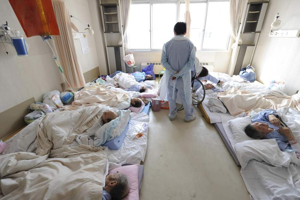 Patients at a hospital wait to be evacuated without medicine and electricity in Otsuchi in Iwate Prefecture (state) Sunday, March 13, 2011, two days after a strong earthquake and tsunami hit northeastern Japan. (AP Photo/The Yomiuri Shimbun, Yasuhiro Takami)