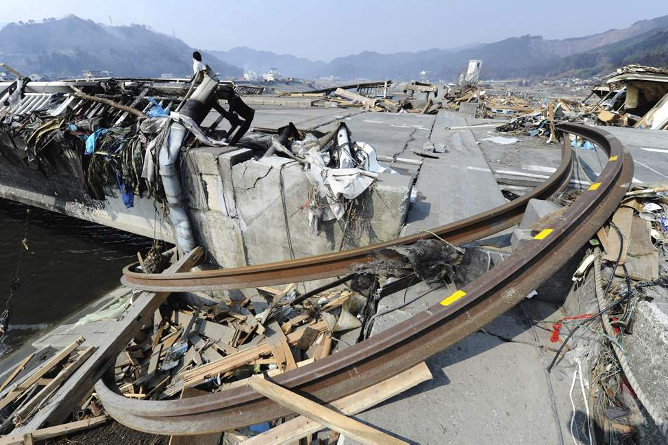In this photo taken Sunday, March 13, 2011, train rails bent by a powerful earthquake-triggered tsunami get stuck by a bridge in Otsuchicho town, northern Japan, two days after the earthquake hit the country's east coast. (AP Photo/The Yomiuri Shimbun, Yasuhiro Takami)