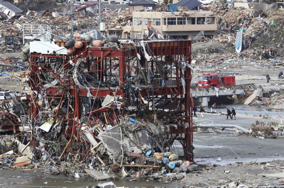 The frame of a building is seen at a devastated area of Minamisanrikucho, northern Japan, Monday, March 14, 2011, three days after a powerful earthquake-triggered tsunami hit the country's east coast. (AP Photo/The Yomiuri Shimbun, Hiroaki Ono)
