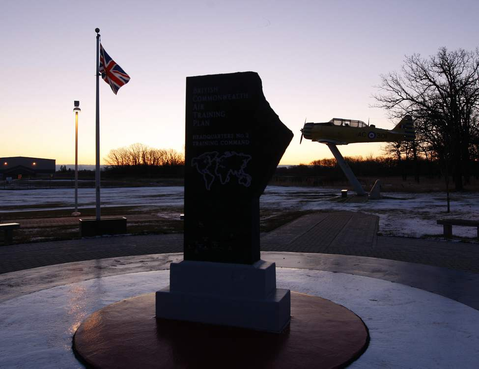 Sunrise over the  British Commonwealth Air Training Plan memorial at  the Garden of Memories  at the Air Force Memorial Park outside the  17 Wing  Air Force Way gate. The BCATP way started in 1939 and trained 131,553  aircrew members  at 100 schools in Canada , with 12 schools  and 14 satellite airfoils in Manitoba that trained pilots from Canada , Australia , New Zealand, and Great Britain.