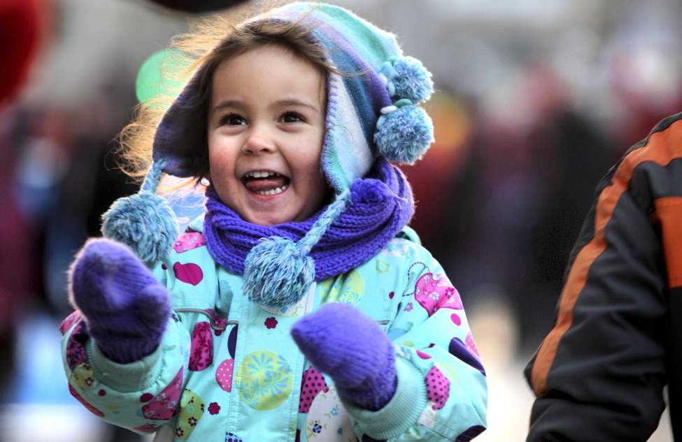 Crowds of wide-eyed children gather with their famiilies  along Portage Avenue Saturday evening for the annual Santa Claus Parade. Three-year-old Summer Tomchuk enjoys playing games on Portage during the block party which took place just prior to the parade. November 17,  2012  (Ruth Bonneville/Winnipeg Free Press)