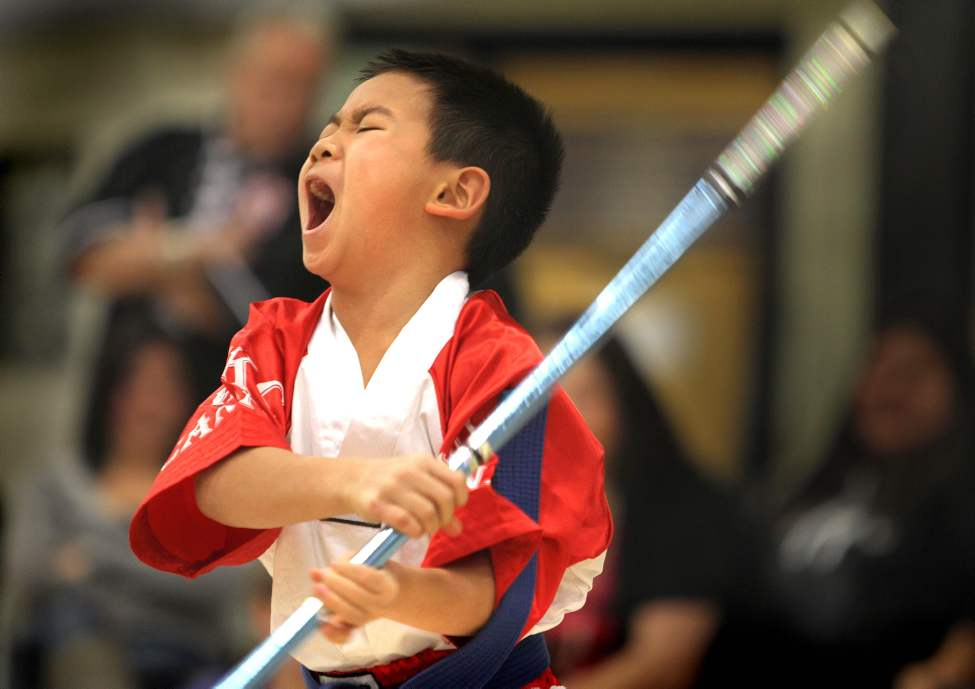 Eight-year-old Kharsun Khamvongsa competes at the 1st Canadian All Martial Arts Open Tournament held at Maples Collegiate Saturday.  The young Canadian National martial arts team member went on to win the Grand Champion trophy in his division.
