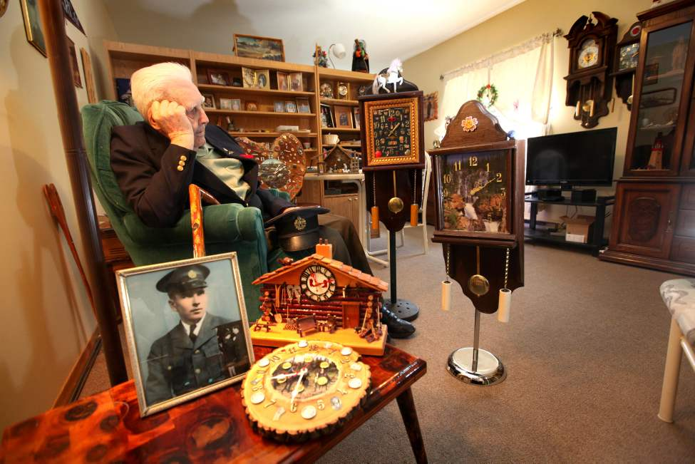 "97-year-old military veteran Joe Kutcher, also known as ""Digger Joe,"" surrounds himself in his quaint suite with time pieces he has made from various pieces of scrap wood, and metal objects he has found over the years. April 26,  2012 (Ruth Bonneville/Winnipeg Free Press)"