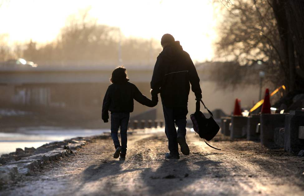 10-year-old Rielly Drummond has a spring in her step as she skips along the River Walk with her dad Antoine after their trip to the Forks for Fish and Chips.  March 14, 2012 (Ruth Bonneville/Winnipeg Free Press)