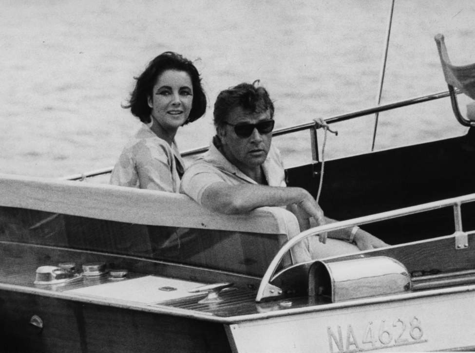 In this June 15, 1962 file photo, Richard Burton and Elizabeth Taylor arrive in a motor launch at the small town Porto d'Ischia, on the isle of Ischia in the Gulf of Naples, Italy for the shooting of some scenes of
