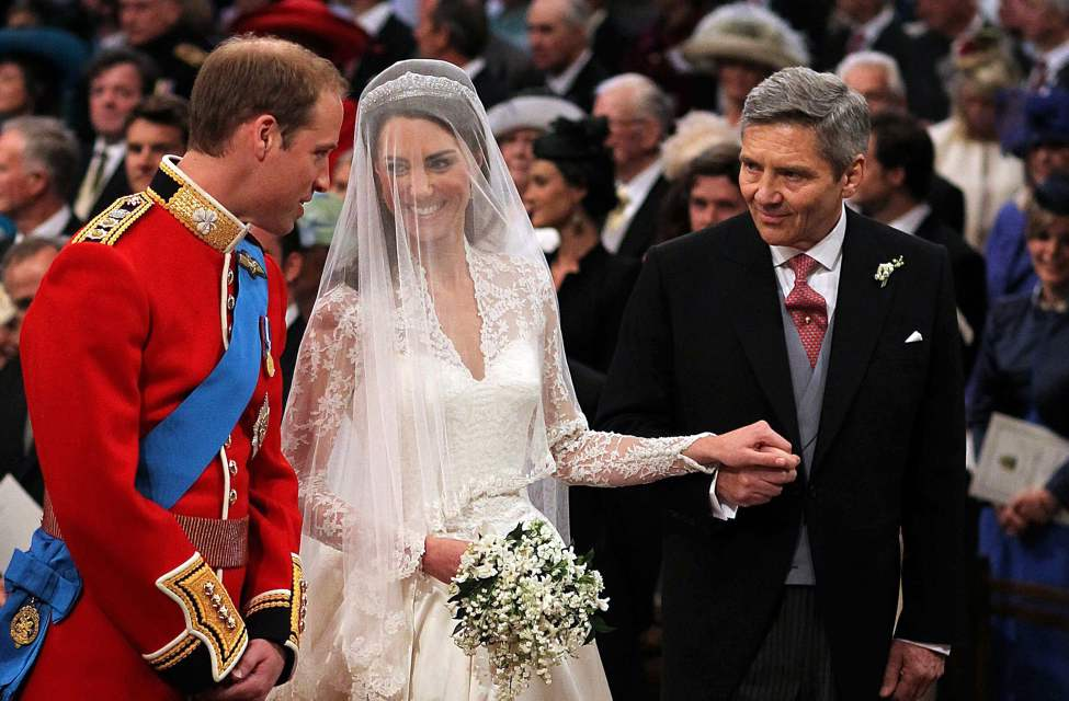 Michael Middleton, right, escorts his daughter Kate Middleton to the altar during her wedding to Prince William at Westminster Abbey in London, England, on Friday, April 29, 2011. (Abaca Press/MCT) (Tribune Media MCT)