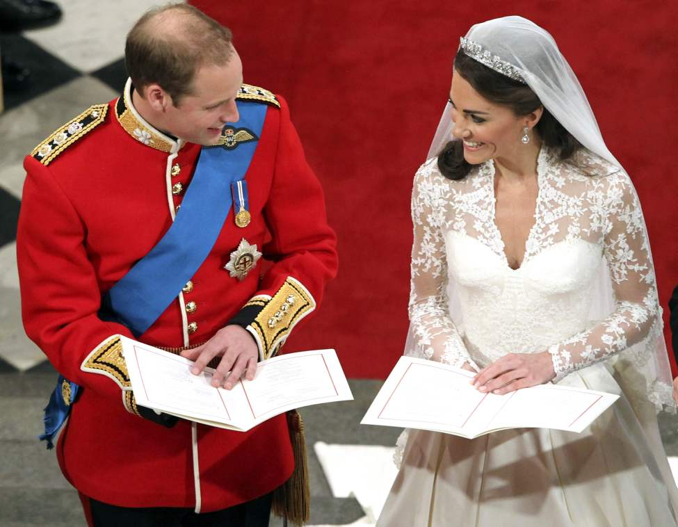 Britain's Prince William and his bride Kate Middleton during their wedding service at Westminster Abbey, London, Friday April 29, 2011. (AP Photo/Andrew Milligan, Pool)