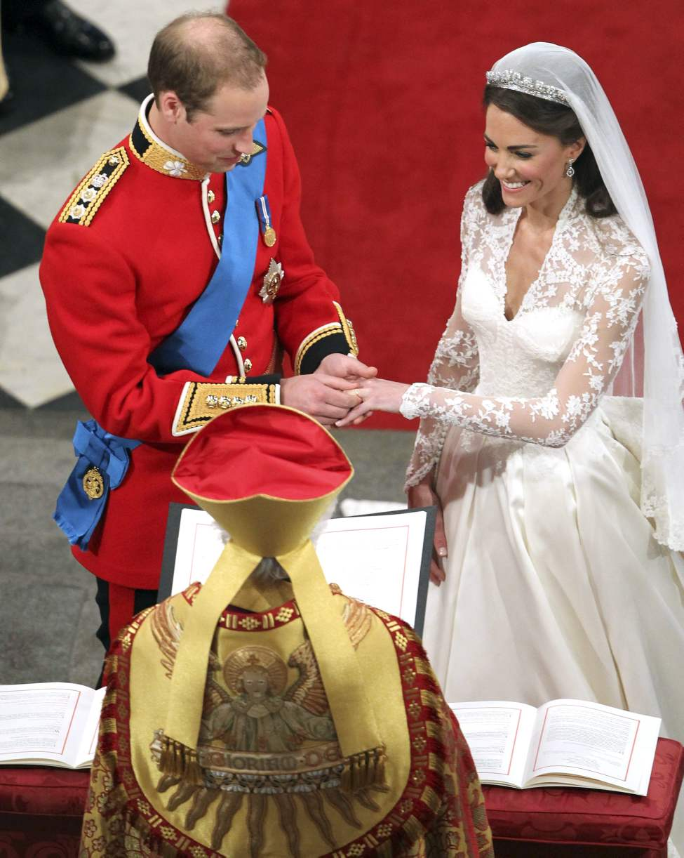 Britain's Prince William and his bride Kate Middleton exchange rings during their wedding service at Westminster Abbey, London, Friday April 29, 2011. (AP Photo/Andrew Milligan, Pool)