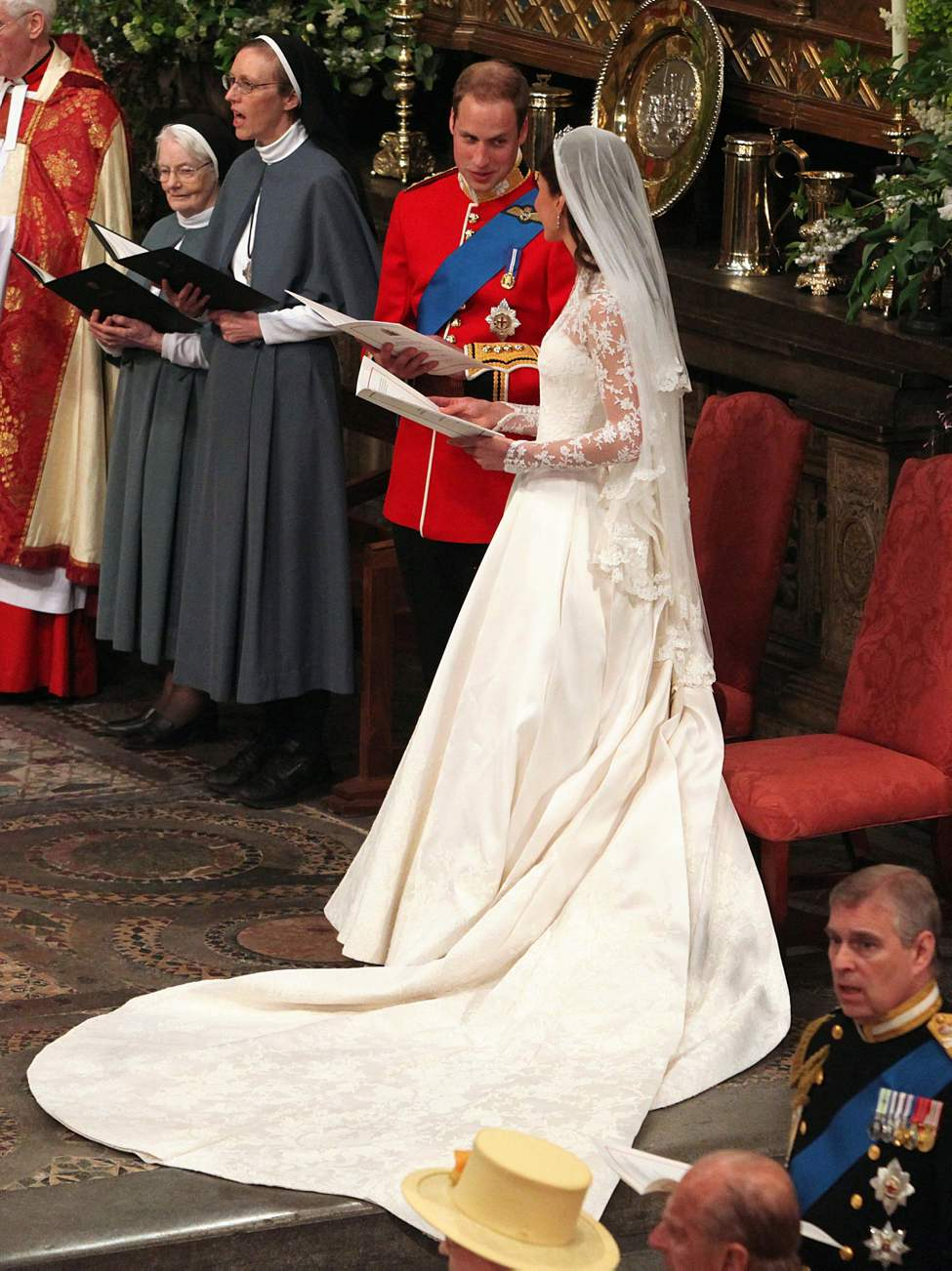 Prince William and Kate Middleton join in singing during their wedding at Westminster Abbey in London, England, on Friday, April 29, 2011. (Abaca Press/MCT)