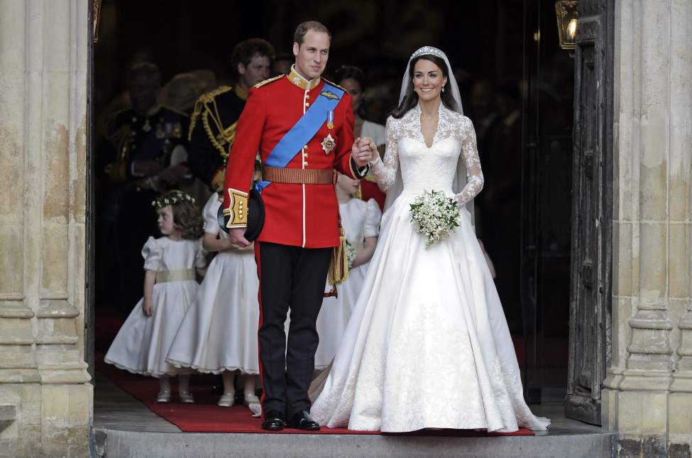 Britain's Prince William and his wife Kate, Duchess of Cambridge stand outside of Westminster Abbey after their Royal Wedding in London Friday, April, 29, 2011. (AP Photo/Martin Meissner) (CP)