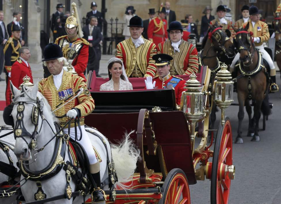 Britain's Prince William, right, and his wife Kate, Duchess of Cambridge, leave Westminster Abbey at the Royal Wedding in London Friday, April, 29, 2011. (AP Photo/Alastair Grant) (CP)