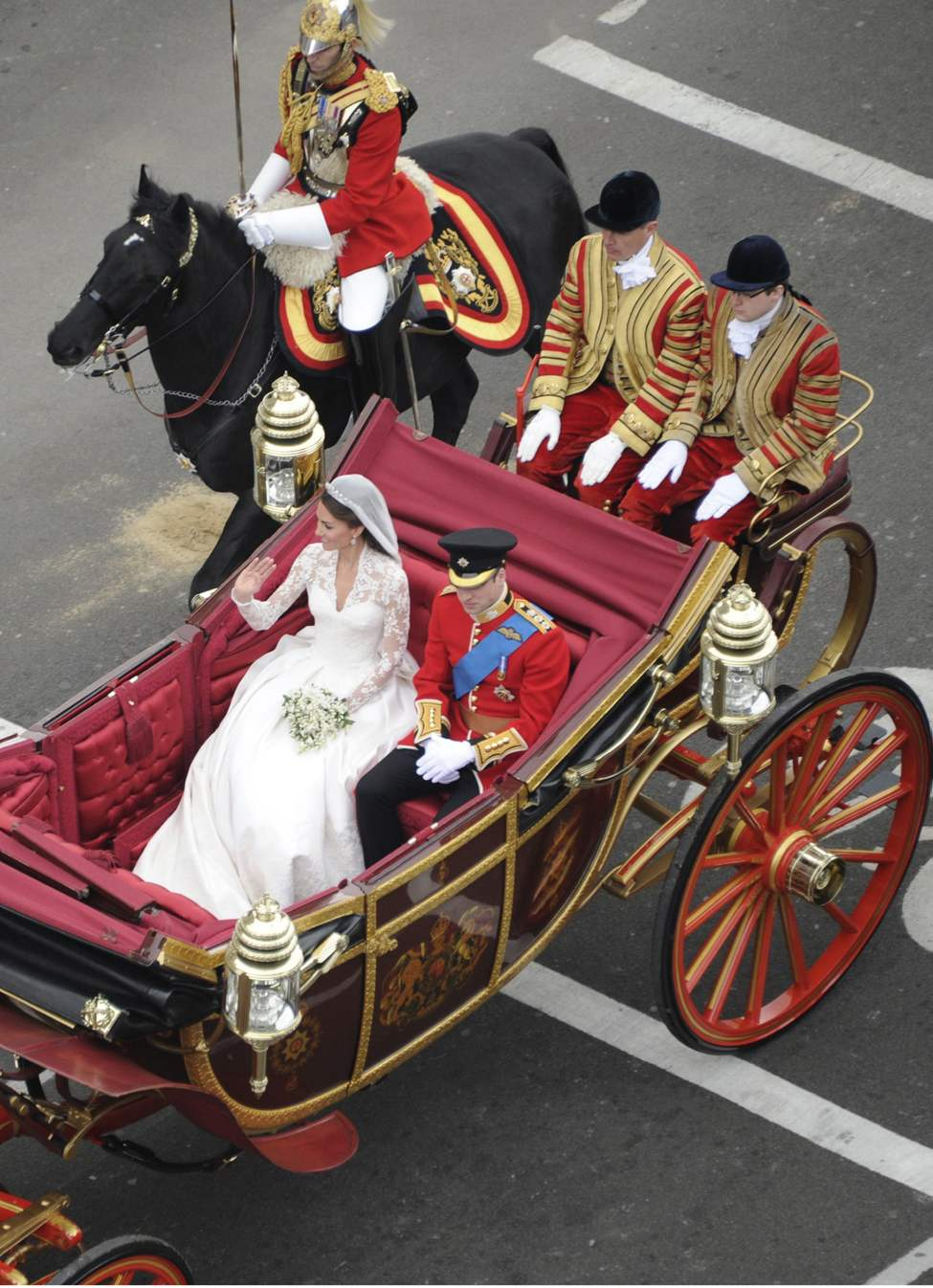 Prince William and his new bride, Kate Middleton, ride in a carriage after their wedding in London, England, on Friday, April 29, 2011. (Abaca Press/MCT)