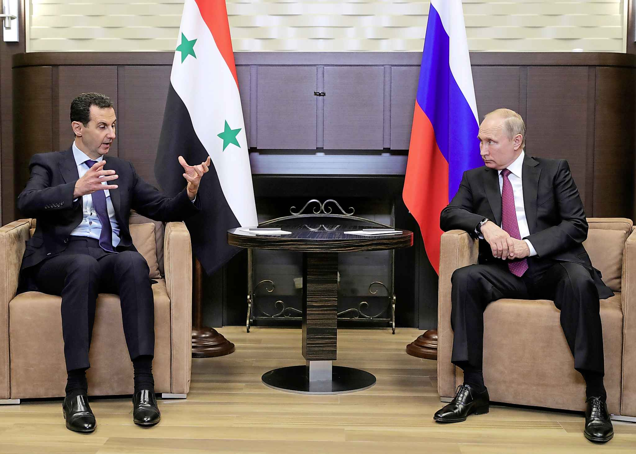 In a desperate stab at self-preservation, Kurdish leaders struck a deal with Syrian President Bashar Assad (left), who, with the support of Russian President Vladimir Putin, committed to sending Syrian forces into northern regions that have long been controlled by Kurds. (Mikhail Klimentyev / Pool / Associated Press files))