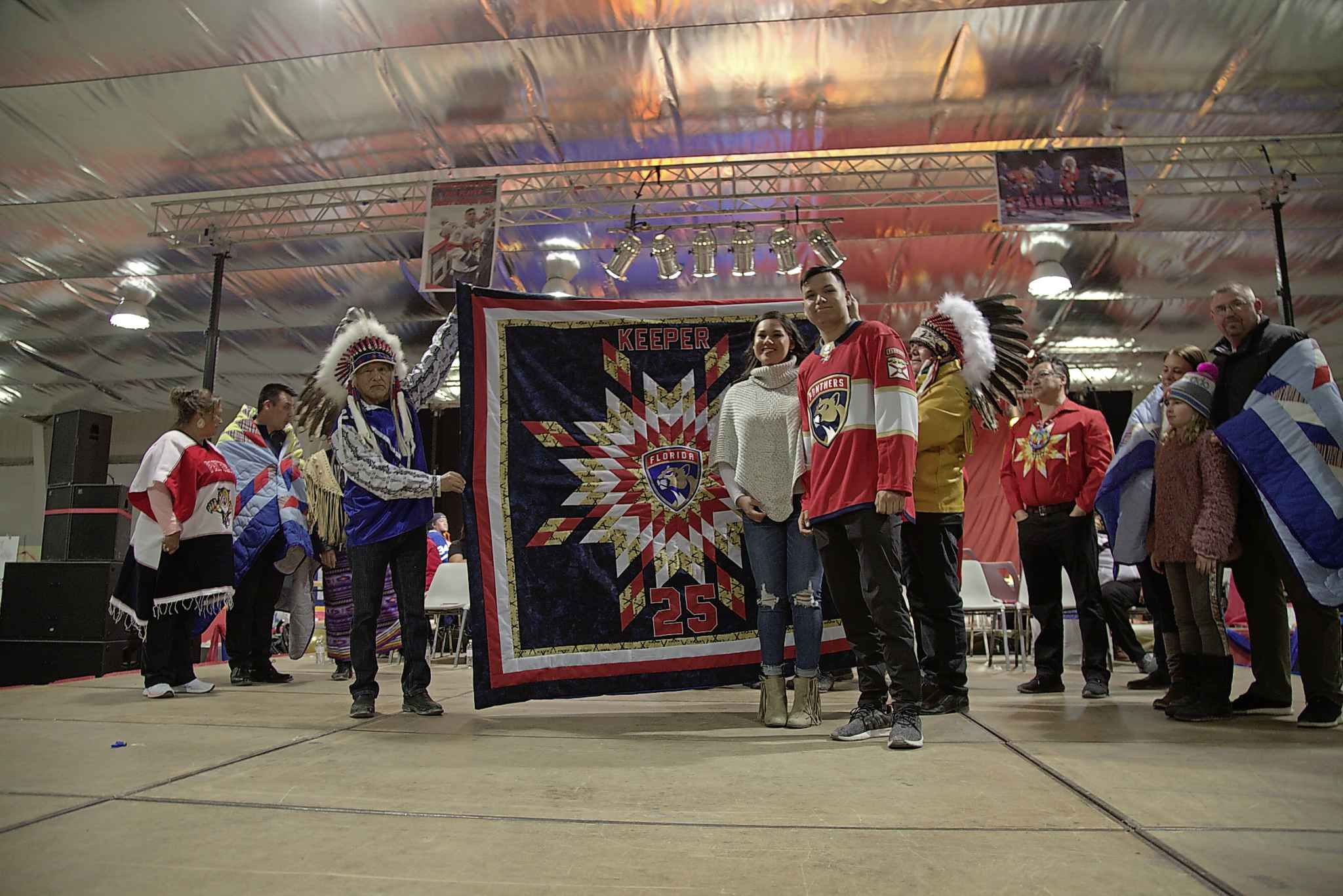 Pimicikamak Chief Tommy Monias and MKO Grand Chief Garrison Settee present Brady Keeper and his girlfriend Shaylyn with a blanket.
