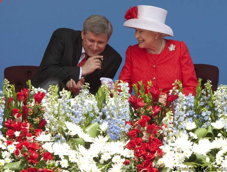 Queen Elizabeth shares a light moment with Prime Minister Stephen Harper at Canada Day events on Parliament Hill Thursday.