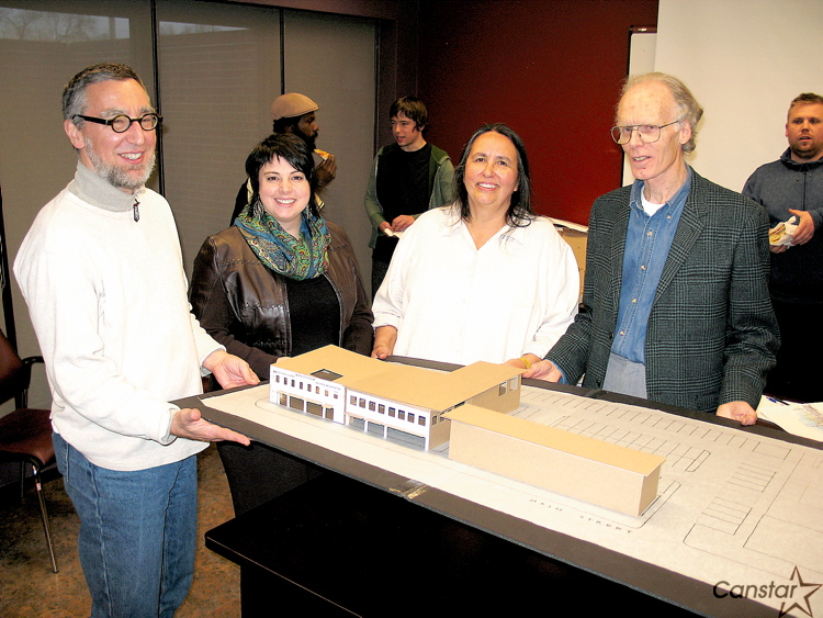 Marcella Poirier and Wins Bridgman of Bridgman Collaborative Architecture show off a model of the proposed Neechi Commons with Neechi Foods Co-op president Louise Champagne and project manager Russ Rothney.