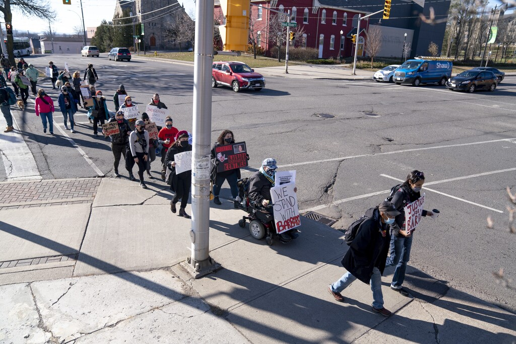 Protesters march toward the courthouse in Thunder Bay on the second day of the manslaughter trial for Brayden Bushby who threw a trailer hitch at Barbara Kentner. (David Jackson / The Canadian Press files)