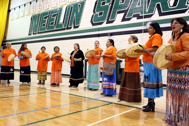 Members of the Sweet Medicine Singers perform during Orange Shirt Day at Neelin High School in Brandon in 2016 in remembrance of the destructive legacy of Canada's residential schools.This year, all events will be online. (Tim Smith / The Brandon Sun files)