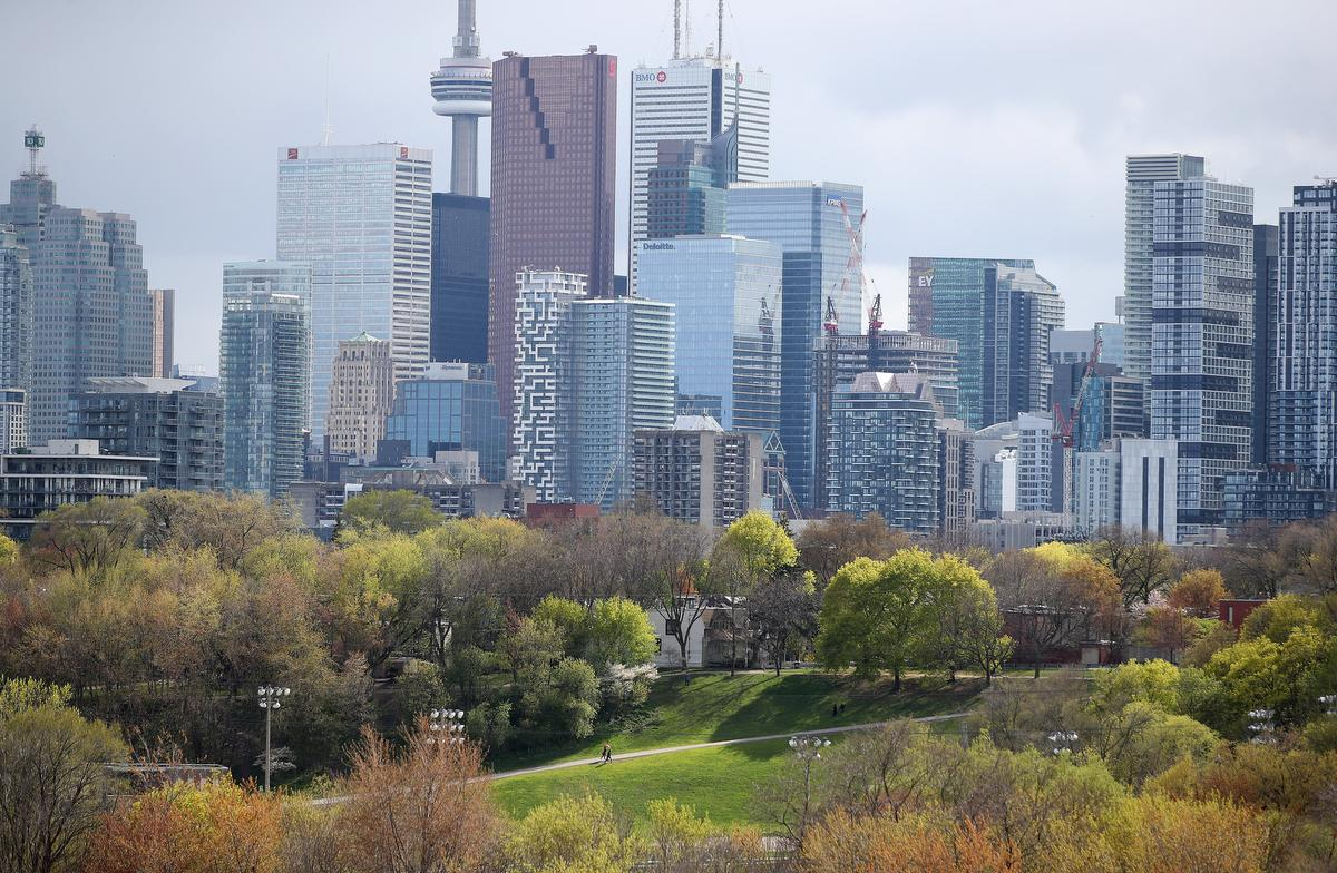 A stroll up the hill at Riverdale Park West earlier this month. Ontario's cautious reopening plans won praise from many scientists for being clear and logical.