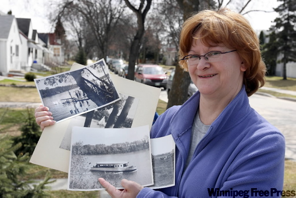 Roberta Horrox displays photographs her late father took in the '30s of Winnipeggers diving into the Red River off swimming docks at Kildonan Park. Roberta took part Sunday morning in one of the Jane's Walk tours in the Scotia Street area.