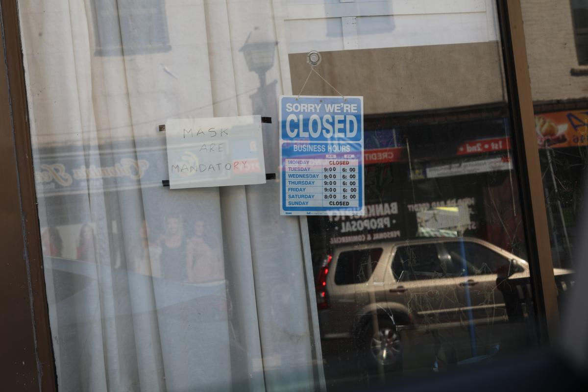 A closed sign on a store in Brampton. Peel Region's Medical Officer of Health Dr Loh issued an order Tuesday that directs all businesses with five or more cases of the COVID-19 virus to temporarily close.