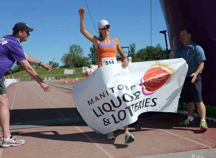 Gina Tranquada wins the women's full race at the 35th Manitoba Marathon Sunday. (Trevor Hagan / Winnipeg Free Press)