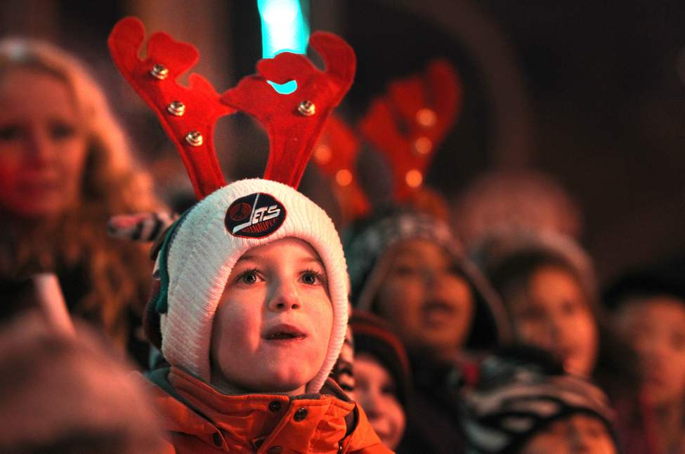 A wide-eyed Noah Brown, 7, watches the Santa Claus Parade on Portage Avenue Saturday. (Ruth Bonneville/Winnipeg Free Press)