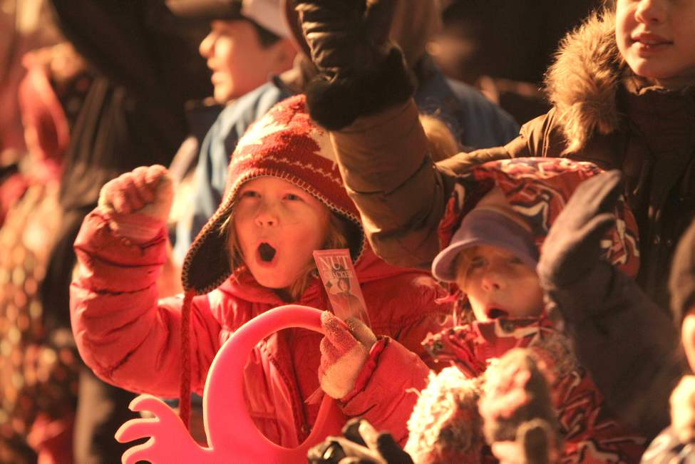 Crowds of wide-eyed and excited children gather with their families  along Portage Avenue Saturday evening during the annual Santa Claus Parade. (Ruth Bonneville/Winnipeg Free Press)