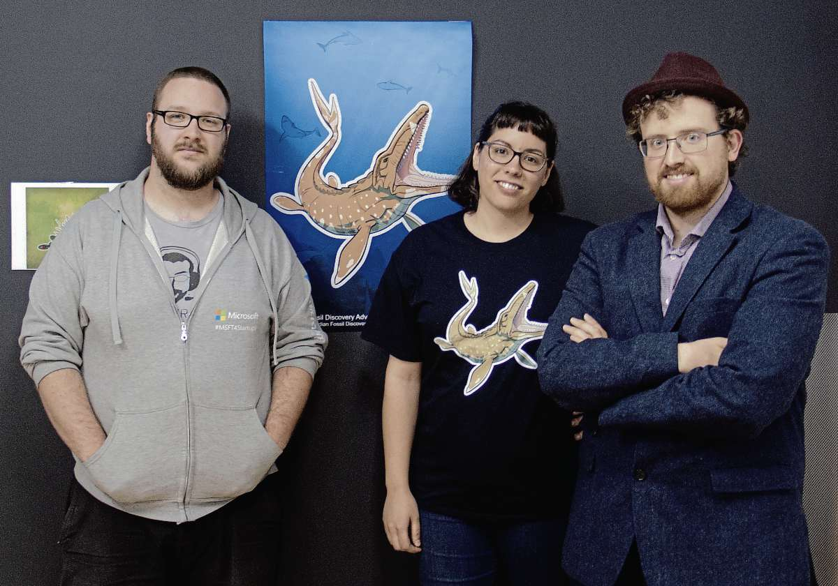 (From left) Dan Blair of BitSpace Development and Danielle and Corey King of ZenFri Inc. are the developers behind the new interactive Fossil Discovery Adventure app for the Canadian Fossil Discovery Centre in Morden, Man. (SHELDON BIRNIE/CANSTAR/THE HERALD)