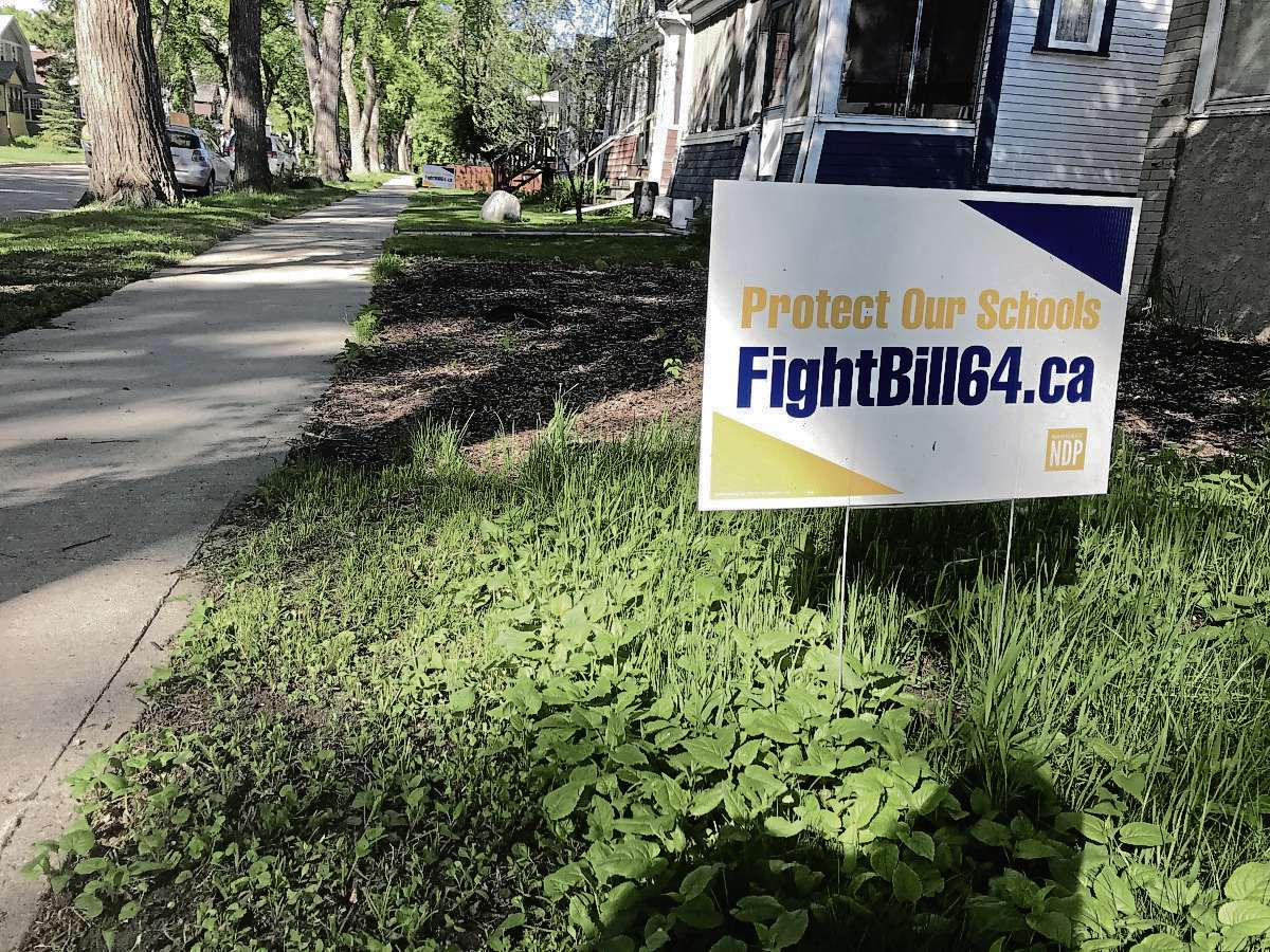 """The provincial NDP have distributed over 2,200 """"FightBill64"""" lawn signs across Manitoba. The provincial Liberals and the Manitoba Teachers' Society, among other groups, also have similar signs available for download or ordering on their websites. (SHELDON BIRNIE/CANSTAR/THE HERALD)"""
