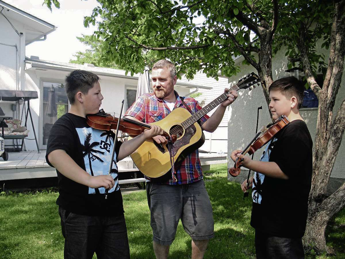 June 17, 2015 - Left to right, Aidan, Rob and Luc Wrigley perform traditional and contemporary fiddle tunes as Double the Trouble. The family band are releasing their debut album July 2 at the Park Theatre. (SHELDON BIRNIE/CANSTAR COMMUNITY NEWS/THE HERALD)